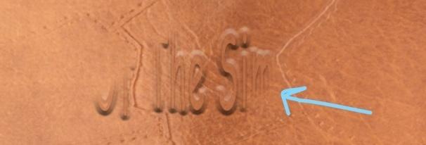 text appear under black brushed mask